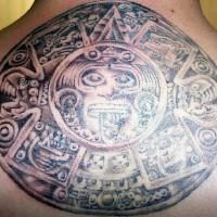 Aztec calendar stone tattoo on upper back