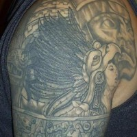 Tribal shaman with eagle feathers tattoo