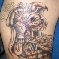 Aztec stylized dead man tattoo