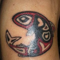 Tribal red and black fish tattoo