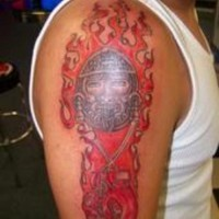 Aztec god of war coloured tattoo