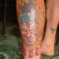 Aztec shaman in flames coloured tattoo