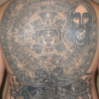 Aztec sun stone and jesus full back tattoo