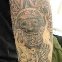 Aztec deity with warrior on hand