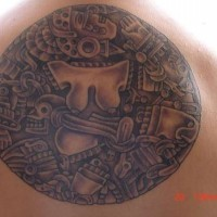 Aztec tracery in circle tattoo
