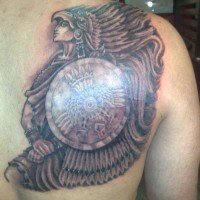 Aztec warrior with shield tattoo on back
