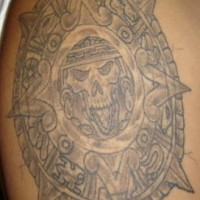 Aztec style calendar of death tattoo on shoulder