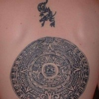 Aztec calendar stone tattoo on back