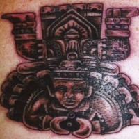 Aztec deity in stone tattoo
