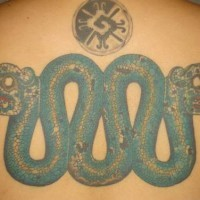 Aztec serpent coloured tattoo