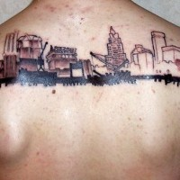 Tattoo  buildings and big cars on upper back