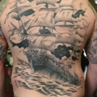 Giant ship on upper back tattoo in stormy sea