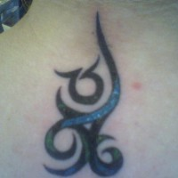 Hieroglyph black and curled tattoo on upper back