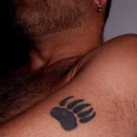 Bear paw print tattoo on arm