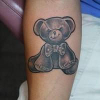 Evil teddy bear tattoo on arm
