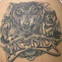 Biker wolf tattoo with inscription live to ride