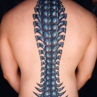 Biomech spine bone coloured tattoo