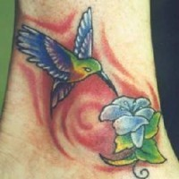 Hummingbird with flower coloured tattoo