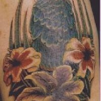 Blue parrot in flowers tattoo