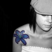 Aquamarine hibiscus tattoo on shoulder