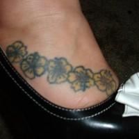 Small yellow flowers of hibiscus tattoo