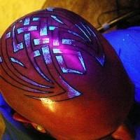 Glowing tracery head tattoo