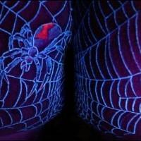 Spider web uv ink tattoo