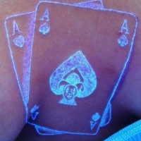 Ace of spades glowing ink tattoo