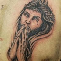 Le tatouage de Jésus priant en couronne d'épines