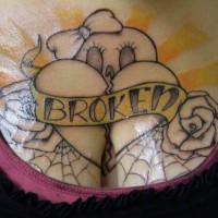 Broken heart with web and roses chest tattoo