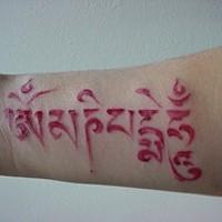 Hindu writings red ink tattoo