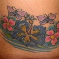 Lower back tattoo,big blue flowers, butterflies
