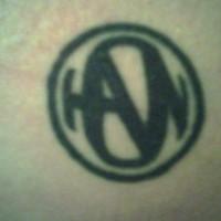 Round sign butt tattoo
