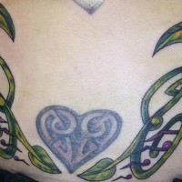 Celtic knot work vine tattoo with heart