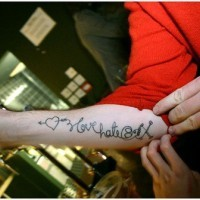 Love text lettering tattoo on arm