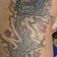 Cherry tree tattoo with colored butterfly