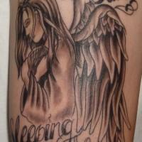 angelo in tristezza memoriale tatuaggio