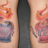 Blue and red sacred hearts tattoo