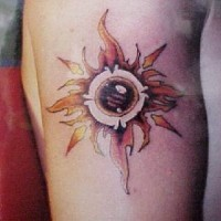 Flaming sun symbol tattoo