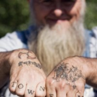 Knuckle tattoo, townfarm, black styled inscription