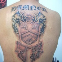 Large family crest damned tattoo on back