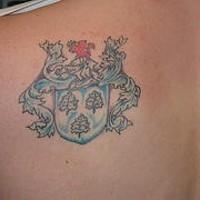 Blue heraldic emblem tattoo