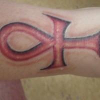 Red ankh arm tattoo