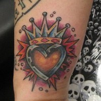 Crowned heart colourful wrist tattoo