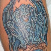 Blue gargoyle tattoo