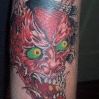 Angry red devil tattoo