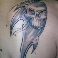 Tribal styvle death tattoo on shoulder