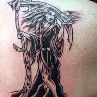 She-death tattoo on shoulder