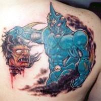 cavaliere azzurro con testa di demone tatuaggio