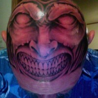 Demon head tattoo, big laughing, teathy face